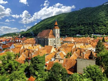 Brasov cityscape with black cathedral and mountain on backround in Romania